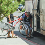 Two people load bikes onto a Big Sky shuttle bus in Bozeman