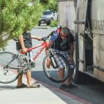 Two people load bikes onto a Big Sky shuttle bus in Bozeman