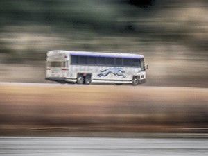 Motion blur image of Greyhound intercity bus